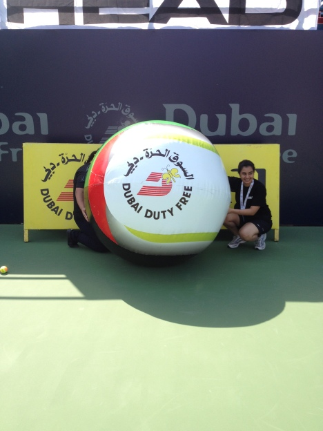 Keeping the giant tennis ball in place!