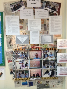 Year 8 examine truth in the media. Key questions about the Media are posted next to the display.